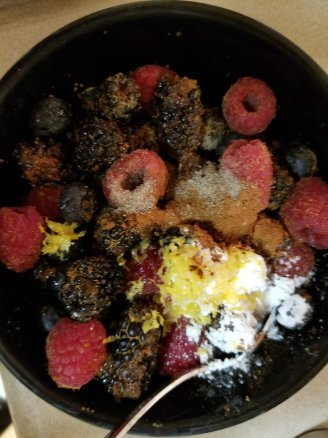 Berries with coconut sugar, maple syrup, cinnamon, lemon juice and lemon zest