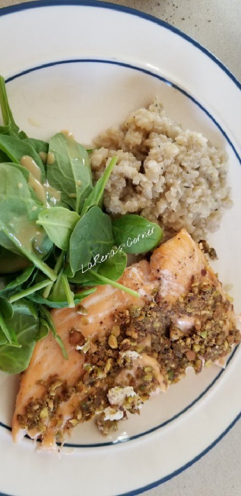 Pistachio Horseradish Salmon with cauliflower rice pilaf and spinach salad with mustard maple dressing