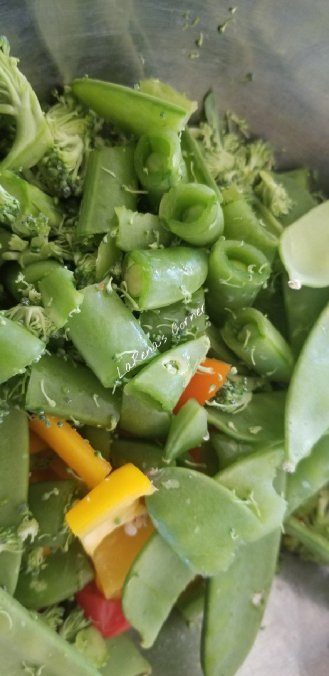 Chopped broccoli, bell peppers, sugar snap peas and whole snow peas
