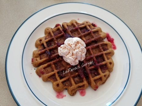 Pumpkin Waffle, Cranberry syrup and whipped cream with a sprinkle of cinnamon