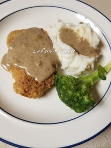 Southern Chicken Fried Pork Chops with mashed potatoes, gravy and broccoli